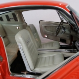 1965 Mustang Fastback Poppy Red white interior